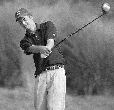 Illinois´ Garrett Chaussard tees off at Urbana Country Club on Sept. 13, 2003. Daily Illini File Photo