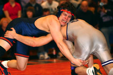 Fourth-ranked Pete Friedl (174) attempts to gain an advantage against Northwestern´s Jake Herbert at Illinois´ last home meet of the season, Feb. 17. The Illini won the meet 29-6 to break the single-season dual win record. Nick Kohout