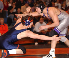 Fourth-ranked Illinois wrestler Pete Friedl lunges for Jake Herbert´s leg at a dual meet against Northwestern on Feb. 17. Friedl won the decision 11-4 to give third-ranked Herbert his first loss of the season. Troy Stanger
