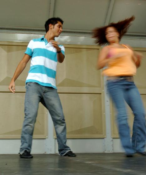Luis Anez, junior in LAS, performs a routine with his Dance 2XS Caliente partner on the Quad day stage, Teusday morning.