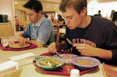 Freshmen Thibaud Smerko in LAS, right, and Richard Otap in Engineering, left, eat lunch at the Allen Hall cafeteria in Urbana on Oct. 9. Dan Hollander The Daily Illini