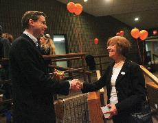 Mike Frerichs shakes the hand of Naomi Jakobsson during their election night party at the Laborers Union Hall in Urbana early Wednesday morning. Jakobsson won for the 103rd District State Representative and Frerichs won for the 52nd District State Senato Josh Birnbaum