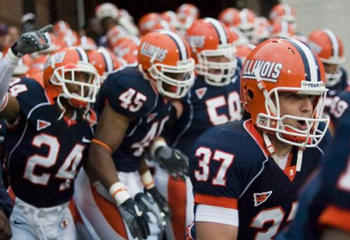 Illinois players enter the field before the 21-0 victory against Western Illinois at Memorial Stadium in Champaign on Saturday. Erica Magda