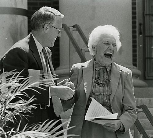 Helene Foellinger, class of 1932, reacts to a hug and kiss from University President Stanley Kenberry at a rededication ceremony on April 26, 1985. It honored her $3.8 million contribution. Daily Illini file photo