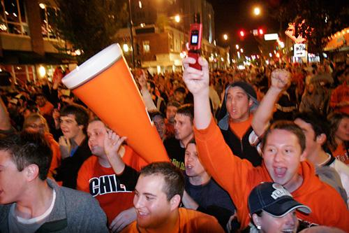 A crowd of Illinois football fans celebrate the 28-21 victory against No. 1-ranked Ohio State on Green Street, Saturday. Both eastbound and westbound traffic was shut down between Wright and Fifth streets as students paraded from Campustown bars to Memor Laura Prusik
