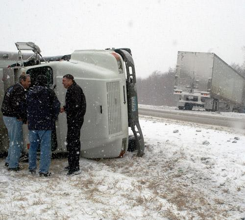 Officials investigate the accident on I-74 involving two semi-trucks Michael Logli