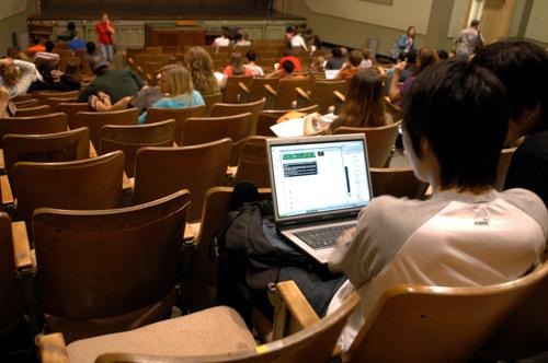 Kevin Koo, sophomore in LAS, goes online on his laptop before his advertising lecture begins in Lincoln Hall. Laptops can help you learn if you use them right.