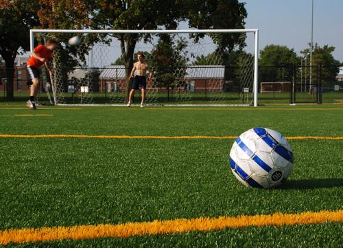 Jake Sicinski, left, sophomore LAS, and Josh Beckman, freshman in LAS, play soccer on the artificial turf by First Street and Stadium Drive.