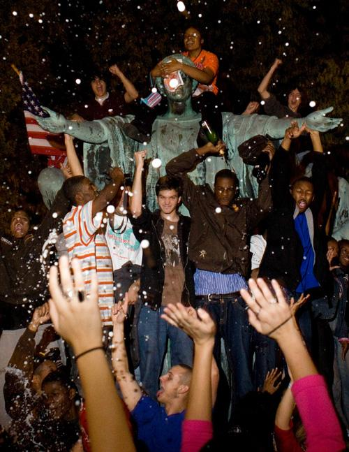 UI student supporters of President-elect Barack Obama celebrate around the Alma Mater by opening bottles of champagne, Tuesday night in Champaign, Ill. For more photos and video from the celebration on campus, log on to www.DailyIllini.com. Erica Magda