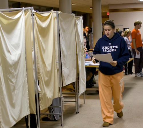 Ali Freter, a freshman in LAS, carries her completed ballot through the Snyder Hall Lounge early Tuesday morning. Erica Magda