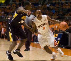 Chester Frazier dribbles to the basket in the game against Iowa on Feb. 1, 2009. Frazier recently agreed to return to Champaign as an assistant men's basketball coach.