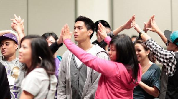 Photo Courtesy of FACT Media Group. Members of the Philippino Student Association play a group game during its 17th annual FACT Conference.