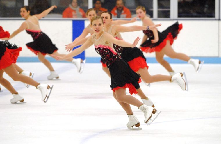 The Illinois Synchronized Ice Skating Team performs during the first intermission at Friday's Illinois Hockey game against the Ohio Bobcats at the Ice Arena.