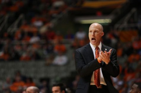Illinois head coach John Groce instructs his team during the exibition game against Northwood at State Farm Center on Sunday. Groce returns just three scholarship players in his second season.