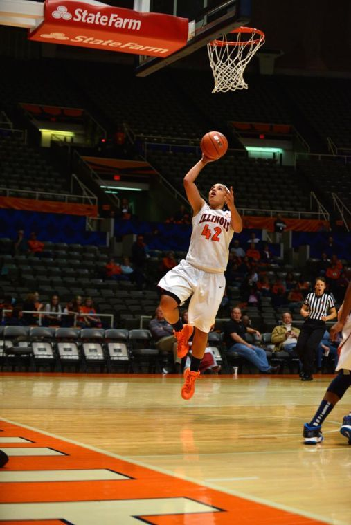 Illinois guard Amber Moore (42) shoots the ball during the game against Valparaiso at State Farm Center in Champaign, Il. on Tues, Nov. 12, 2013.