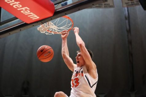 Illinois Jon Ekey dunks the ball off a missed shot during the game against Bradley at State Farm Center, on Sunday. The Illini won 81-55.