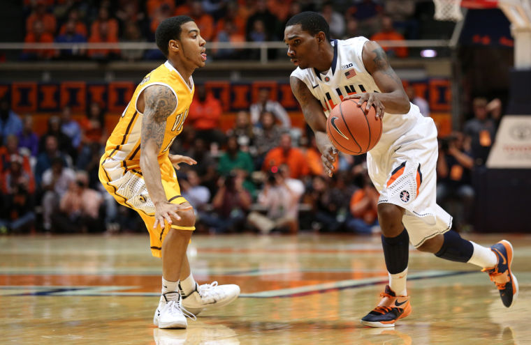Illinois%27+Tracy+Abrams+%2813%29+drives+to+the+basket+during+the+game+against+Valparaiso+at+State+Farm+Center%2C+on+Wednesday%2C+Nov.+13%2C+2013.+The+Illini+won+64-52.