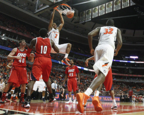 Illinois' Joseph Bertrand (2) dunks the ball during the game against Illinois-Chicago at the United Center on Saturday, Dec. 28, 2013. The Illini won, 74-60.