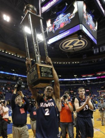 Illinois' Joseph Bertrand celebrates a 65-64 win against Missouri in the Braggin' Rights game at the Scottrade Center in St. Louis on Saturday, Dec. 21, 2013.
