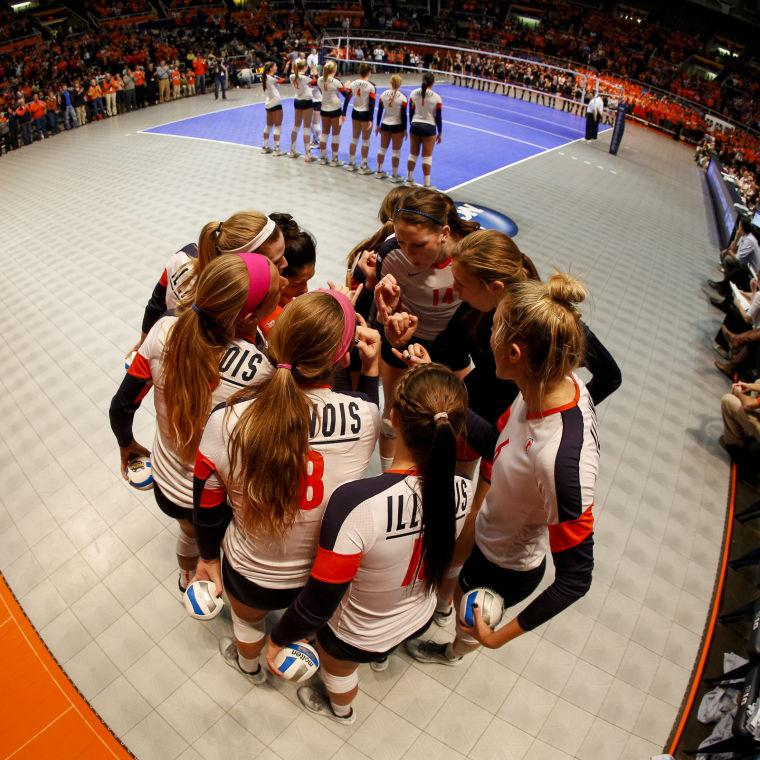 Illinois huddles together before an NCAA regional semifinal match against Purdue at State Farm Center on Friday, December. 13, 2013. The Illini lost, 3-0.