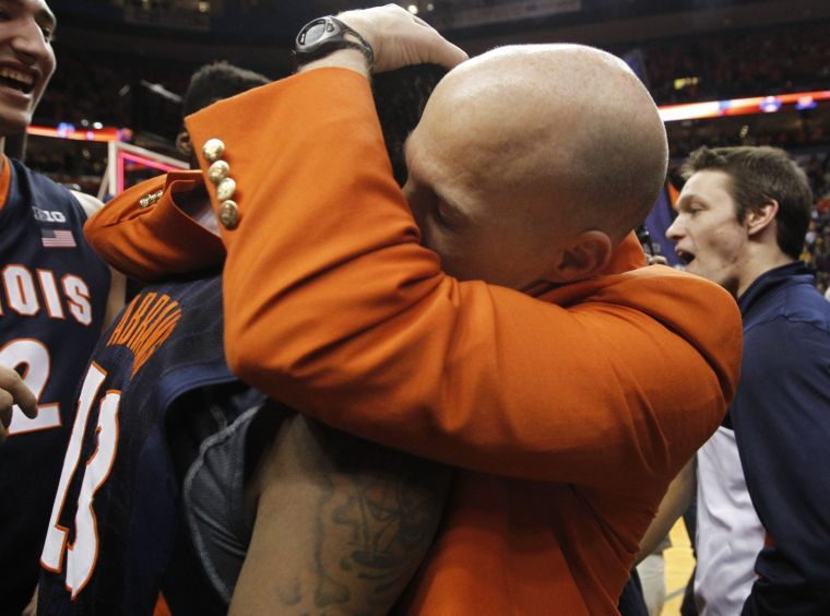 Illinois' Tracy Abrams gets a hug from head coach John Groce after a 65-64 win against Missouri in the Braggin' Rights game at the Scottrade Center in St. Louis on Saturday, Dec. 21, 2013.