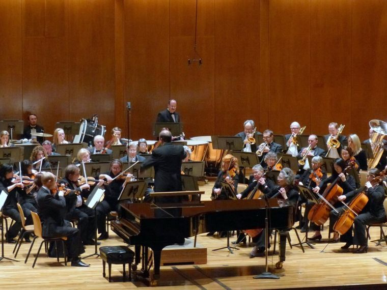 Stephen Alltop conducts the Champaign-Urbana Symphony Orchestra in front of an audience at Krannert Center for the Performing Arts on March 9.