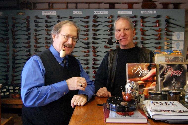 Jon's Pipe Shop Tobbaconists Patrick Callaghan and Michael Ladue show off their extensive collection of pipes in their new location in Downtown Champaign on Dec. 9, 2013.