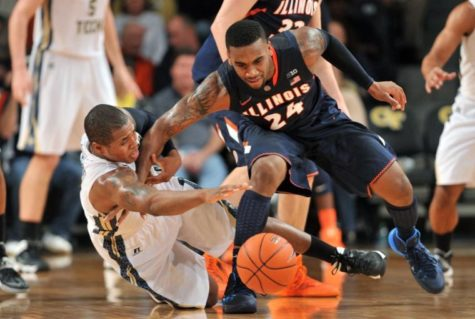 Georgia Tech's Marcus Georges-Hunt falls to the floor as he fights for a loose ball with Illinois' Rayvonte Rice in the first half of the Big Ten ACC Challenge game at McCamish Pavilion in Atlanta on Tuesday.