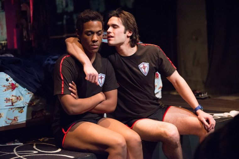 "William Rose III (left) and Maxwell Tomaszewski (right) perform as Justin Simmons and Brandon Hardy during the dress rehearsal of ""Good Boys and True"" which premiered at the Station Theater in Urbana, Il. on Thursday."