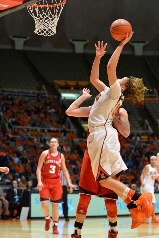 Illinois' Ivory Crawford (22) lays up the ball during the game against Nebraska at State Farm Center on Sunday, Jan. 12, 2014. The Illini lost 75-56.