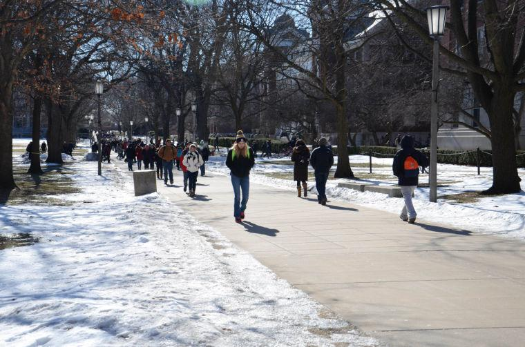 Students walk on the Quad all bundled up in order to fight the cold, on Tuesday, Jan. 28th in the afternoon.
