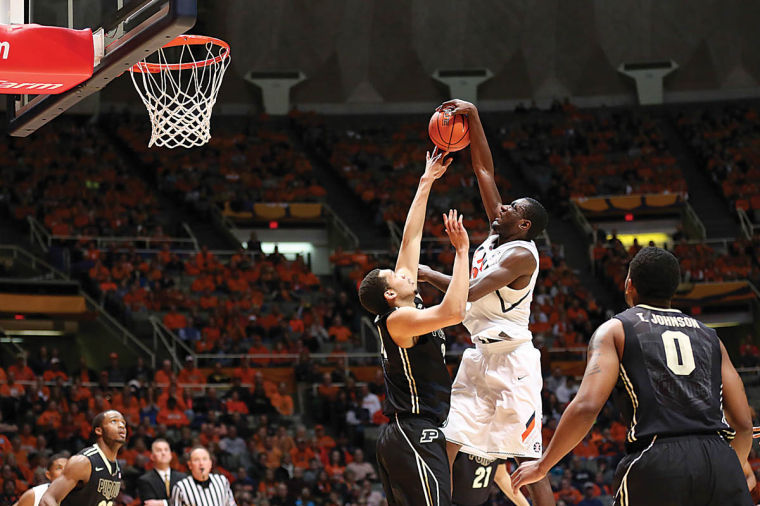Illinois' Nnanna Egwu is blocked by Purdue's A.J Hammons during the game against Purdue at State Farm Center on Wednesday. The Illini lost 66-58 extending their losing streak to three games.