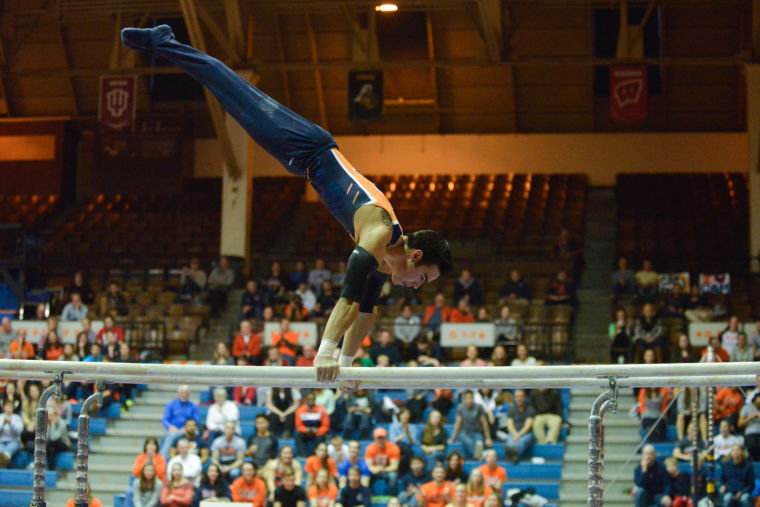 Jordan+Valdez+performs+the+parallel+bars+routine+against+Ohio+State+at+Huff+Hall+on+Sunday%2C+Jan.+26th%2C+2014.