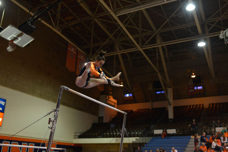 Illinois' Giana O'Connor performs the uneven bars routine during the meet against Centenary and Wisconsin Eau Claire at Huff Hall on Saturday. The Illini won with 196.175 points.