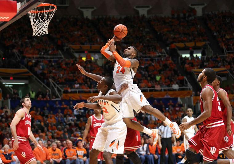 Illinois' Rayvonte Rice (24) attempts a layup after drawing contact during the game against Indiana at State Farm Center, on Tuesday, Dec. 31, 2013. The Illini won 83-80.
