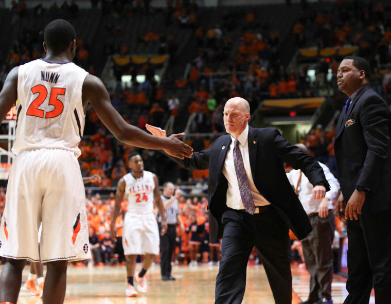 Illinois head coach John Groce gives Kendrick Nunn (25) a high-five during the game against Nebraska at State Farm Center on Wednesday, Feb. 26, 2013. The Illini won 60-49.
