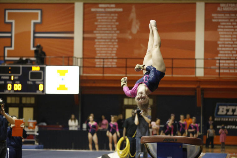 Illinois%27+Erin+Buchanan+competes+her+vault+pass+during+a+dual+meet+against+Iowa+at+Huff+Hall+on+Friday%2C+Jan.+31%2C+2014.+Buchanan+placed+first+with+a+score+of+9.875.