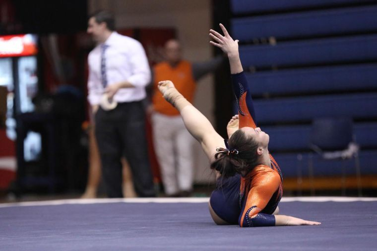 Illinois%27+Kelsi+Eberly+finishes+her+floor+routine+during+the+meet+aginast+Ohio+State+and+Central+Michigan+at+Huff+Hall%2C+on+Sunday%2C+Feb.23.+The+Illini+finished+first+with+a+score+of+196.775.