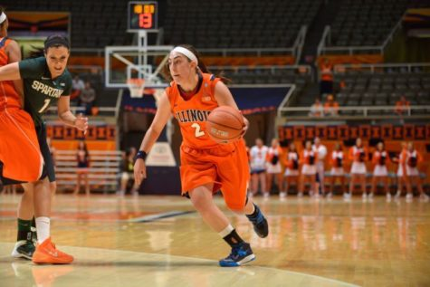 Illinois' Taylor Gleason (2) dribbles the ball during the game against Michigan State at State Farm Center on Wednesday, Feb. 5, 2014. The Illini lost 69-53.
