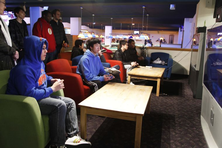 Students Justin Hughes and Jamie Pu participate in a Super Smash Brothers Brawl Tournament this past Saturday afternoon in the Union's basement.