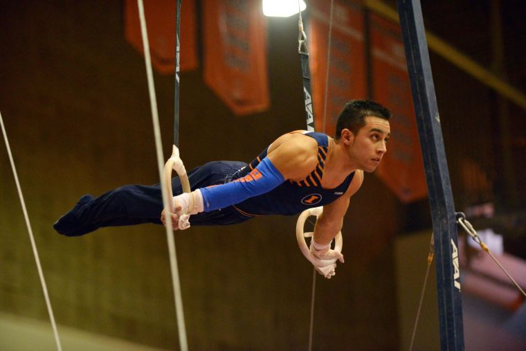 C.J.+Maestas+performs+the+rings+routine+against+Ohio+State+at+Huff+Hall+on+Jan.+26.