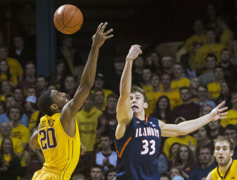 Illinois' Jon Ekey goes for the ball against Minnesota at Williams Arena on Wednesday, Feb. 19, 2014. Editor's Note: A previous version of this caption incorrectly stated that the Illinois game against Minnesota took place at Mariucci Arena. The game took place at Williams Arena. The Daily Illini regrets the error.