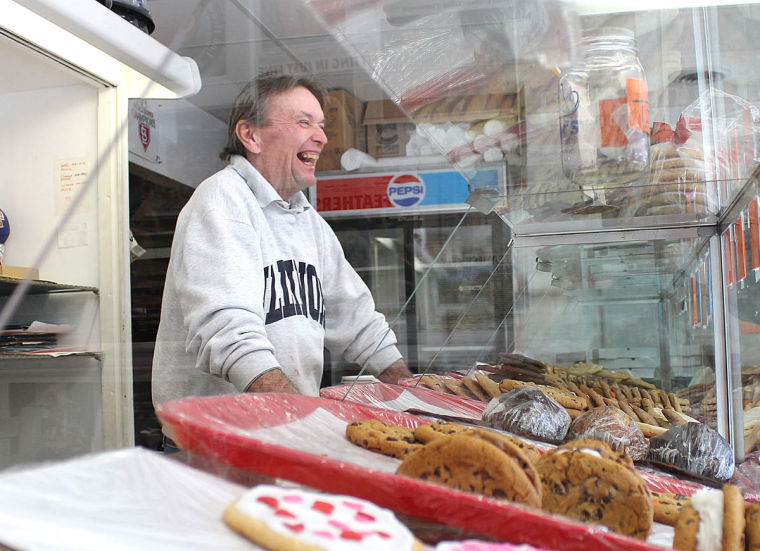 Ed Brubaker, owner of The Cookie Jar, laughs with a customer while working at his shop on Monday, Feb 10. The week of Valentine's Day is one of the busiest for him.