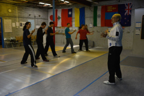 Michael Vitoux teaches a group of students the basics of fencing at The Point Fencing Club in Champaign.