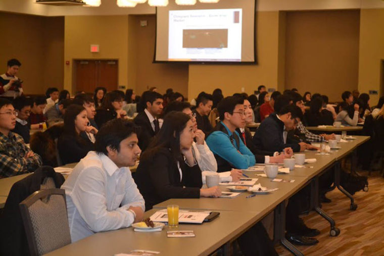 Students listen to a panel discussion on nuances of conducting business in the U.S. at the I Hotel and Conference Center in Champaign on Saturday. The panel discussion was a part of the