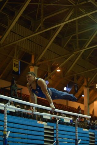 Freshman Chandler Eggleston performs his parallel bars routine against Ohio State at Huff Hall on Jan. 26. Eggleston failed to make the United States national team.