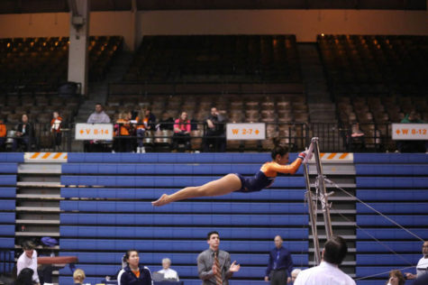 Illinois' Sunny Kato preforms her routine of the uneven bars during the meet against Michigan at Huff Hall, on Feb. 7, 2014.