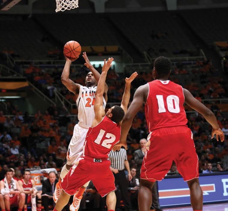 Illinois' Rayvonte Rice is called for a charge after attempting a shot during the game against Wisconsin at State Farm Center, on Tuesday. The Illini lost 75-63.