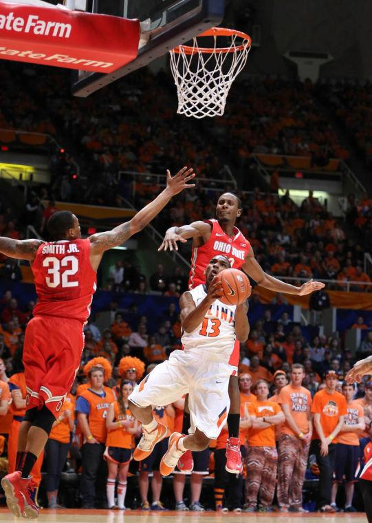 Illinois' Tracy Abrams (13) attempts a complicated shot during the game against No. 22 Ohio State at State Farm Center on Saturday, Feb. 15, 2014. The Illini lost 48-39.