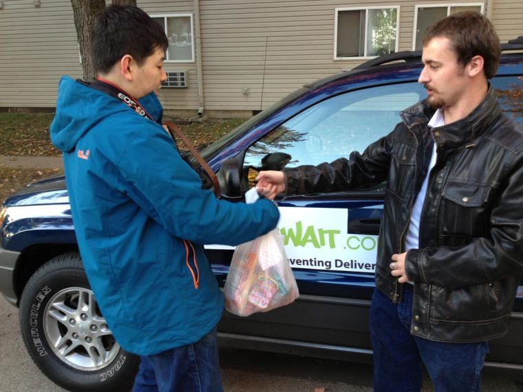 TJ Wukitsch, senior vice president of KantWait, delivers an order from Far East Grocery while operating the grocery route.